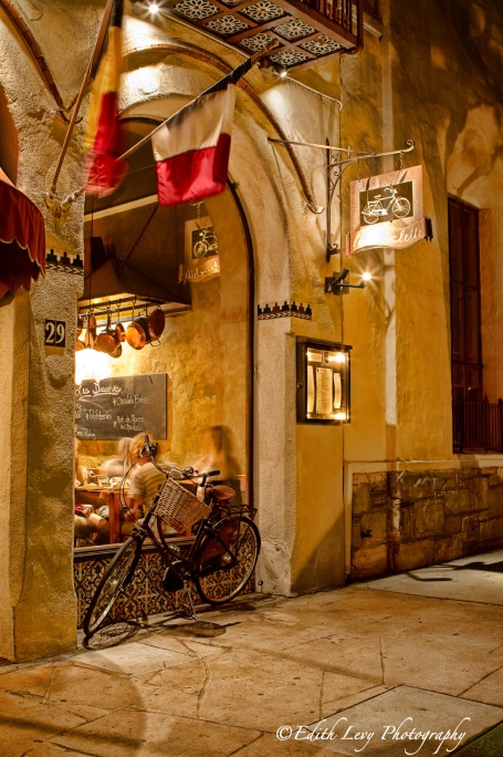 Carmel, California, night, bicycle, La Bicyclette, restaurant, window, French, flags, dining, travel photography