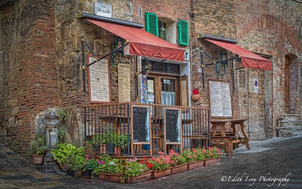 Montepulciano, Tuscany, Italy, restaurent, brick building, flowers, travel photography